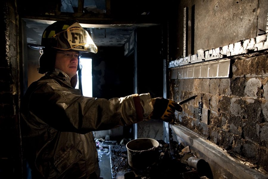 MISAWA AIR BASE, Japan -- Master Sgt. Lee Manley, 35th Civil Engineer Squadron fire inspector and investigator, points out burn patterns in the kitchen of a Misawa home Feb. 12. The fire reinforced Sergeant Manley's advice to Misawa residents to keep renter's insurance, not leave cooking unattended and to crawl below the smoke to exit a burning building safely. (U.S. Air Force photo/Staff Sgt. Samuel Morse)